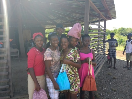 Ninotte and young women with their menstrual kits